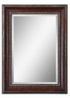 This wooden frame features a distressed, dark mahogany wood tone