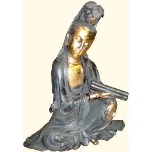 Chinese Quan Yin statue sitting in black dress: Home