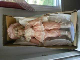 AND ARTISTRY IN DESIGNING ANTIQUE REPRODUCTION PORCELAIN DOLLS