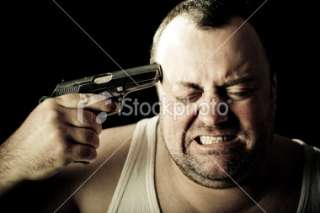 Man ready to commit suicide with a gun Royalty Free Stock Photo